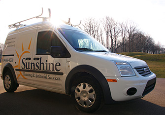Sunshine cleaning and janitorial services trucks